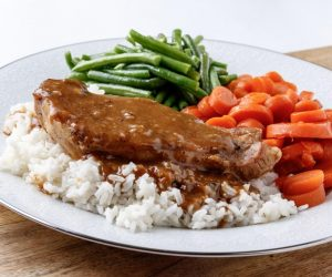 THURSDAY: SMOTHERED PORK CHOPS OVER RICE,and your choice of two sides: GLAZED CARROTS, GREEN BEANS, OR MACARONI & CHEESE